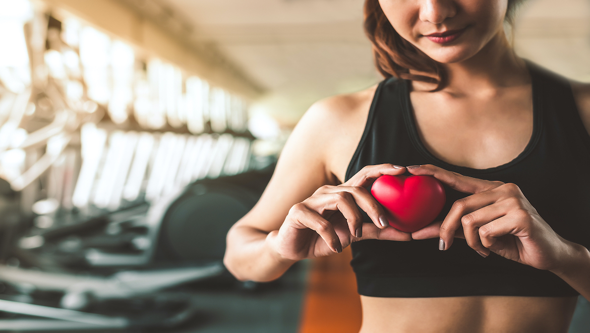 Woman Holding a Red Heart Before Cardio Exercises